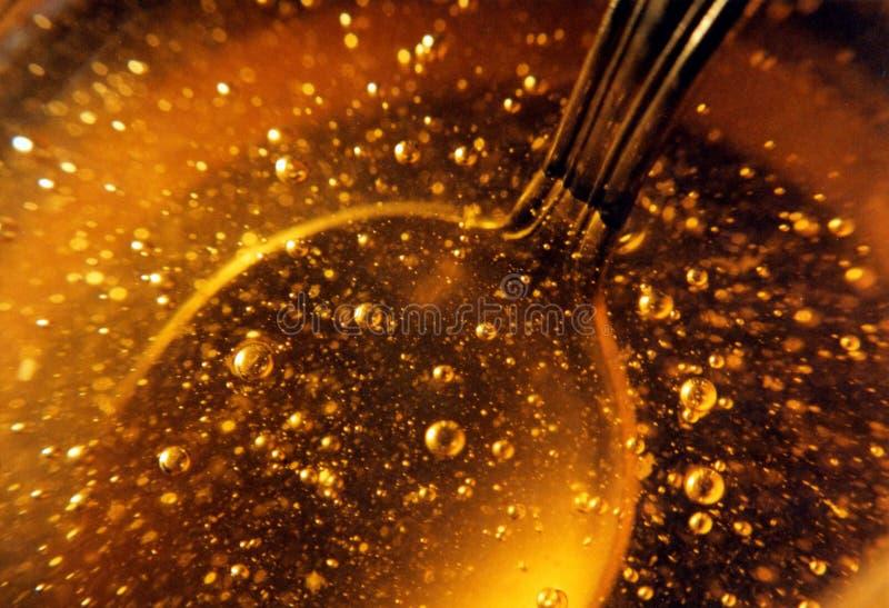 Honing in een kruik stock afbeeldingen