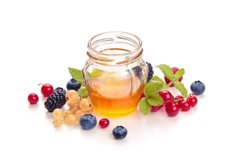 Honing en bessen stock afbeelding