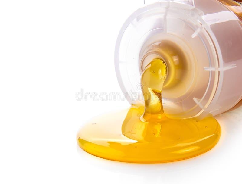 Honing in plastic die buis op witte achtergrond wordt geïsoleerd royalty-vrije stock foto's