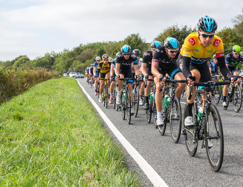 Bradley Wiggins in the 2013 Tour of Britain Cycle. HONITON, UK - SEPTEMBER 20: Bradley Wiggins wears the IG Yellow Jersey as current tour leader, in the pack of royalty free stock images