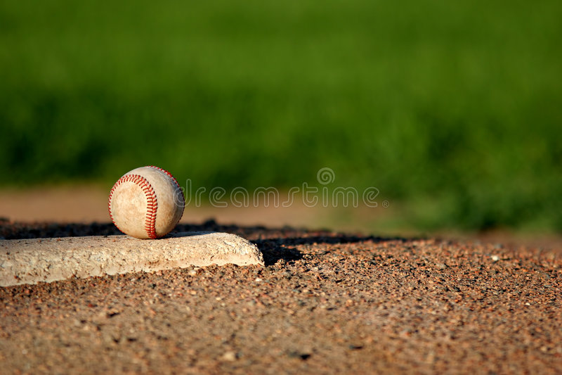 Honkbal op waterkruikenhoop stock foto