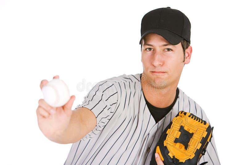Honkbal: Speler die de Bal werpen stock foto