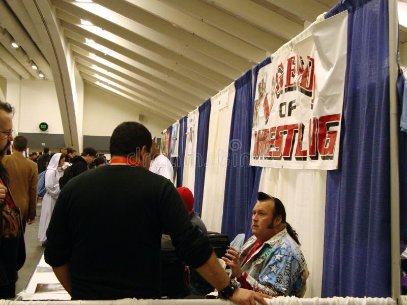 The Honky Tonk Man talks to fan at event. San Francisco -  April 4, 2010: Former Wrestler The Honky Tonk Man talks to fan at WonderCon event at moscone stock photos