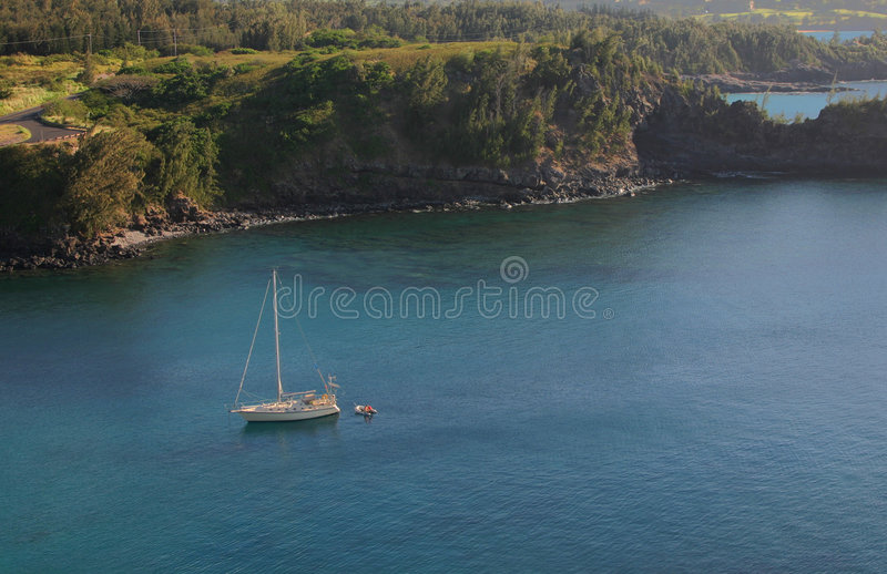Honolua Bay with Sail Boat. On crystal clear blue water in Maui Hawaii stock images