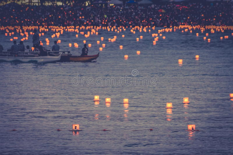 Honolulu, Hawaii, USA - May 30, 2016: Memorial Day Lantern Floating Festival held at Ala Moana Beach to honor deceased loved ones. Crowds gather at the Memorial royalty free stock photo