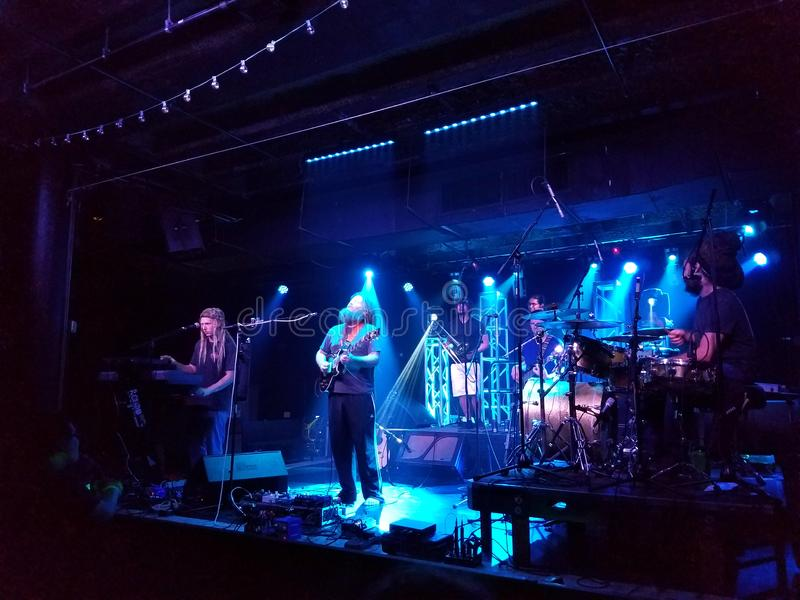 Mike Love Band plays music indoors with cool lighting at Crossroads. Honolulu - May 17, 2017: Mike Love Band plays music indoors with cool lighting at Crossroads stock photo