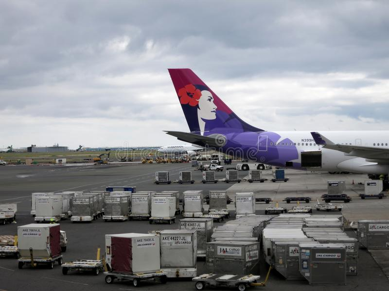 Tail of Hawaiian Airlines airplane as it sit at airport as it pr stock photos