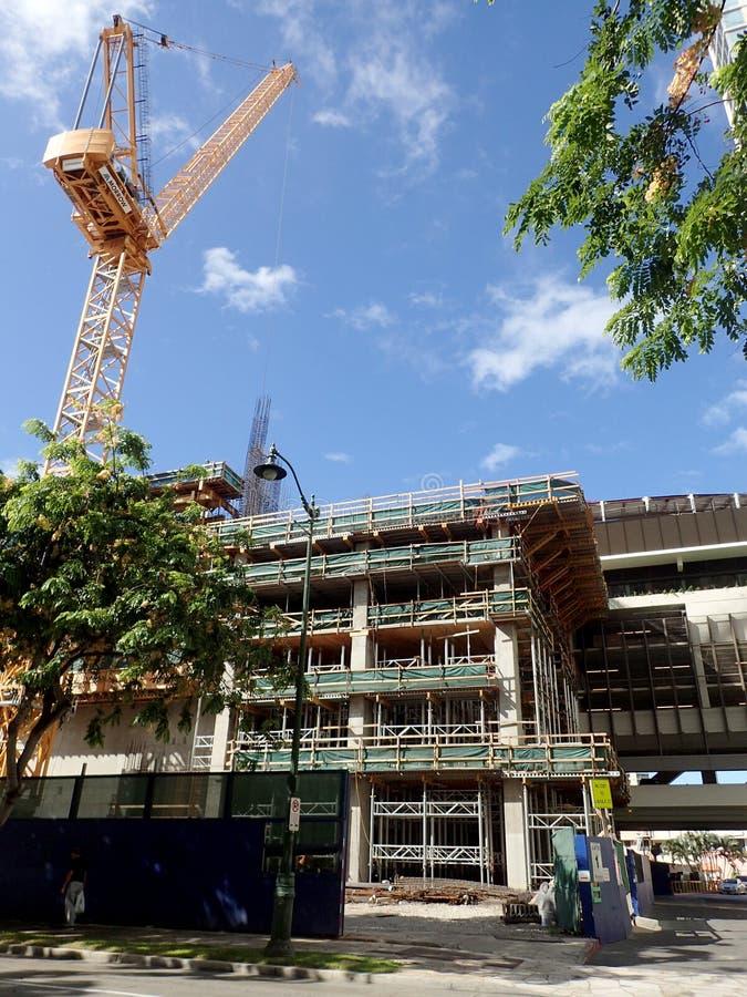 Construction Crane builds The Ritz-Carlton Residences royalty free stock photography