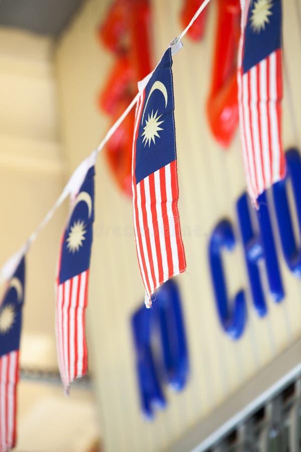 Honom girland av malaysiska flaggor fotografering för bildbyråer