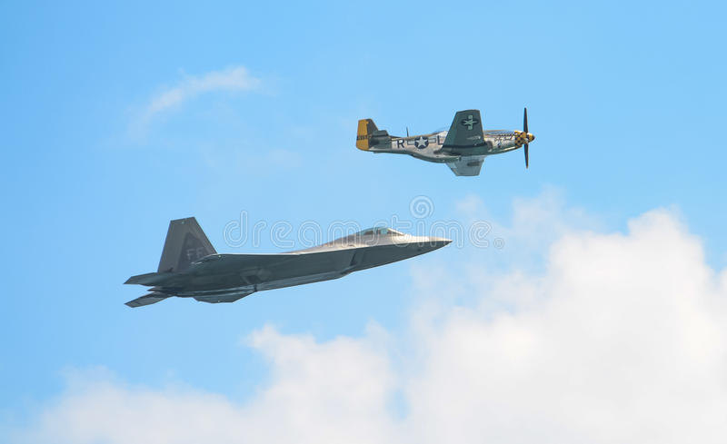 Honor Flight. An honor flight, commemorating the heritage of generations of design and development in US air power, featuring a P-51 Mustang and an F-22 Raptor stock images