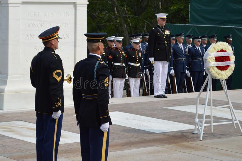 Honor Guard. At the tomb of the unknown soldier. A Japanese dignitary came to pay his respects by laying a wreath at the tomb stock photos
