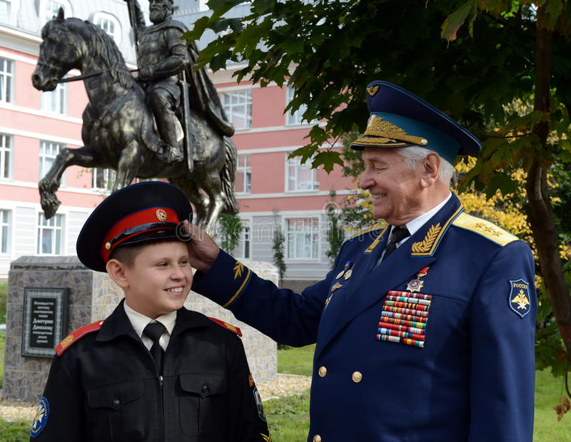 Honored military pilot, colonel general of aircraft Nikolay Moskvitelev with the Moscow cadet. MOSCOW, RUSSIA - SEPTEMBER 1, 2014:Honored military pilot stock photo