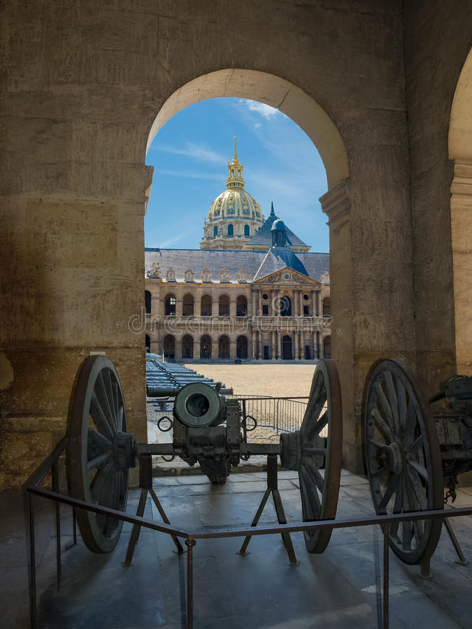 Honorific Courtyard, church of Saint-Louis des Invalides in Paris. View through the arch to the Honorific Courtyard and a northern facade of the Saint Louis Des royalty free stock image