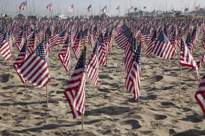 Honoring 9-11. SANTA BARBARA, CA - SEP. 11: 2977 U.S. Flags placed on the beach by UCSB College Republicans and Young America's Foundation to remember those stock image