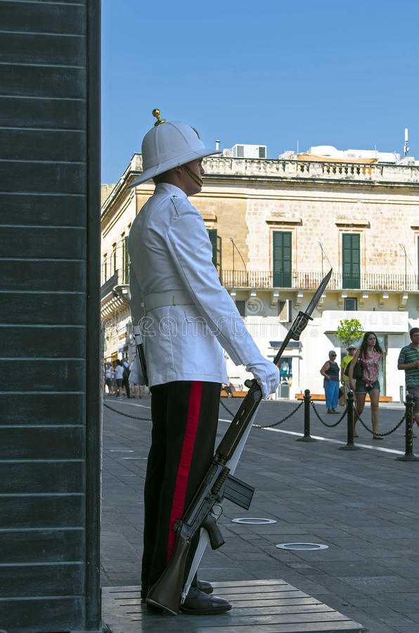 Honour guard. Malta, Valletta - July 31, 2015: Honour guard in front of the Grand Masters Palace stock photos