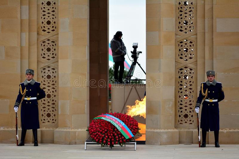 Honour guard at monument in Baku, Azerbaijan, on the anniversary of the civilian killings. BAKU, AZERBAIJAN - JANUARY 20 2014 An honour guard of two soldiers and stock photos