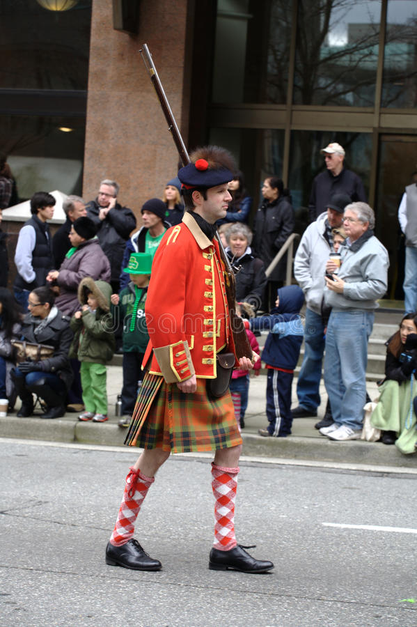Honour Guard, St. Patrick's Day Parade. A member of the 78th Fraser Highlanders Honour Guard marches in the regiment's historical uniform and carries a musket stock photos