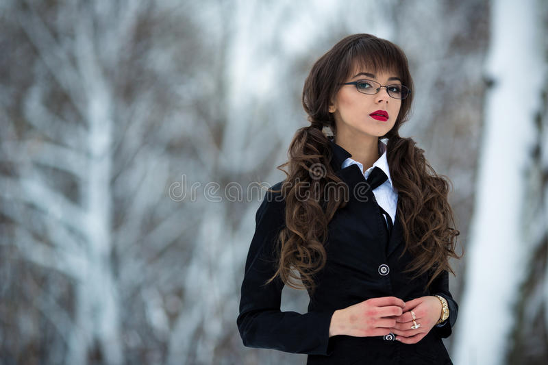 Seductive,well-educated,smart,sexual,clever,wise,beautiful,attractive with perfect appearance,glasses,red lips.Teacher,student. royalty free stock photography