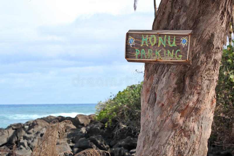 Honu Parking Sign on Turtle Beach in North Shore, Oahu, Hawaii. Honu (turtle) parking sign on Turtle Beach in Haleiwa, North Shore, Oahu, Hawaii. The sign is stock photo