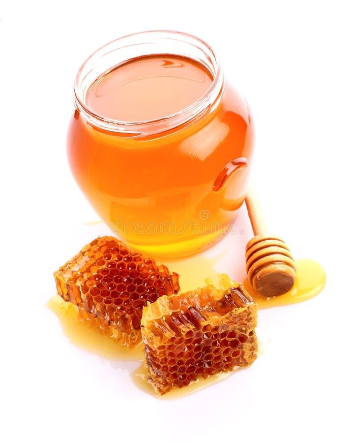 Honung med honungskakor arkivfoton