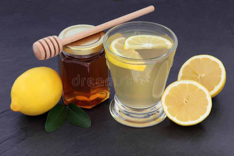 Honung- och citrondrink royaltyfri fotografi