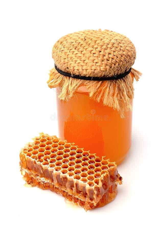 Honung- och honungskakacloseup royaltyfri bild