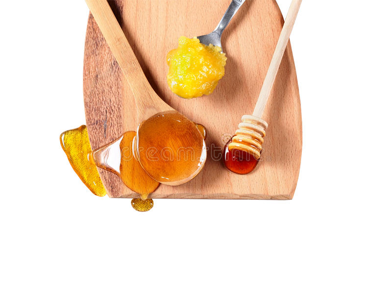 Honung på träskärbräda royaltyfri fotografi