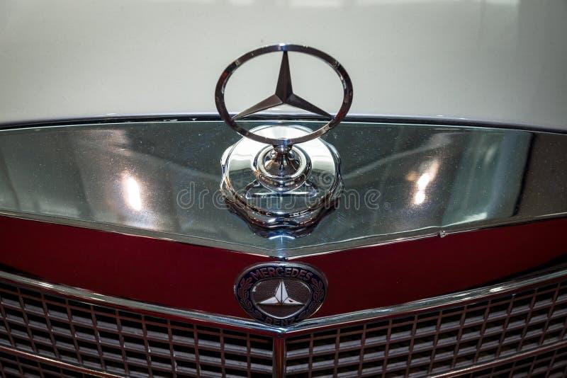 Hood ornament of Mercedes-Benz three-beam star, closeup. stock images
