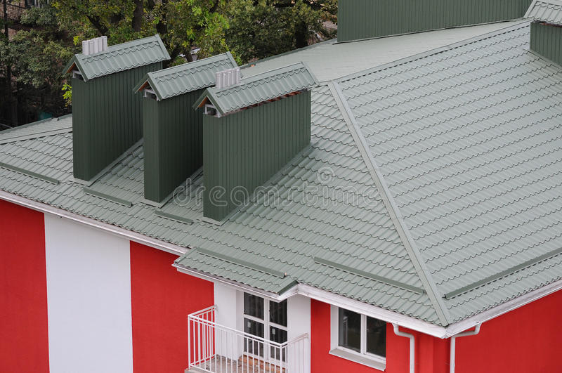 Hood on the roof of the metal sheets. Roofing materials. royalty free stock photography