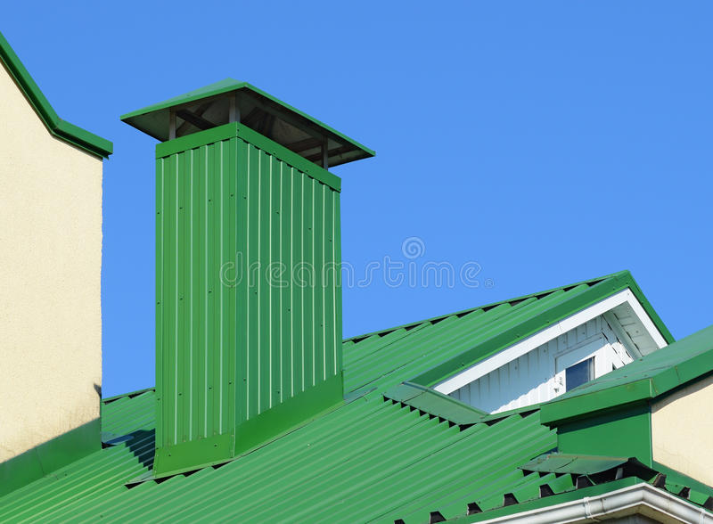 Hood on the roof of metal sheets. Hood on the roof of the metal sheets. Roofing materials royalty free stock photos