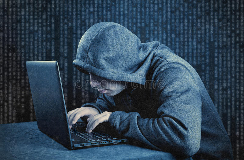 Hooded computer hacker stock image