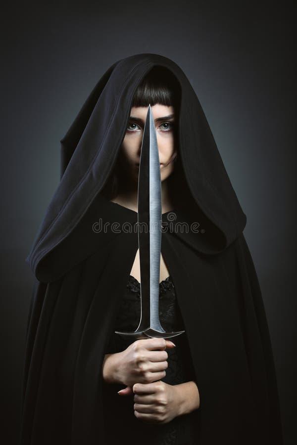 Hooded fantasy assassin royalty free stock photography