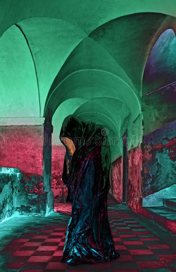 Alien - Hooded Figure Alien Looks To The Future. Hooded Figure in the castle without faces. The light comes out of the face of Hooded Figure stock images