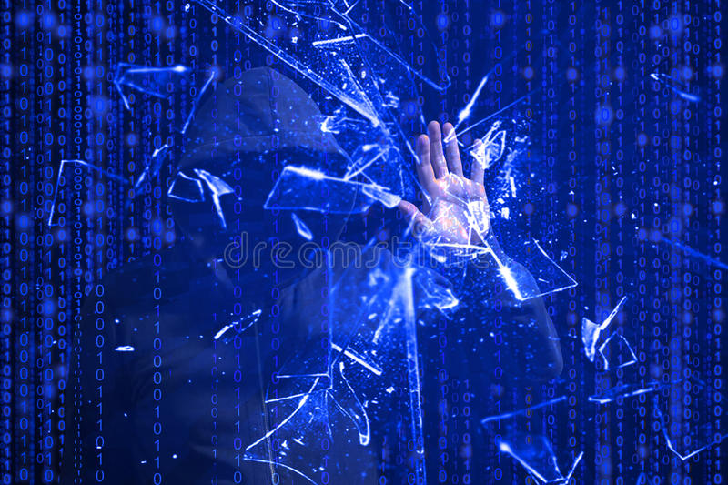 Hooded hacker smashing blue screen with one hand. Hooded hacker smashing the screen with one hand in front of blue binary background cybersecurity concept stock photography