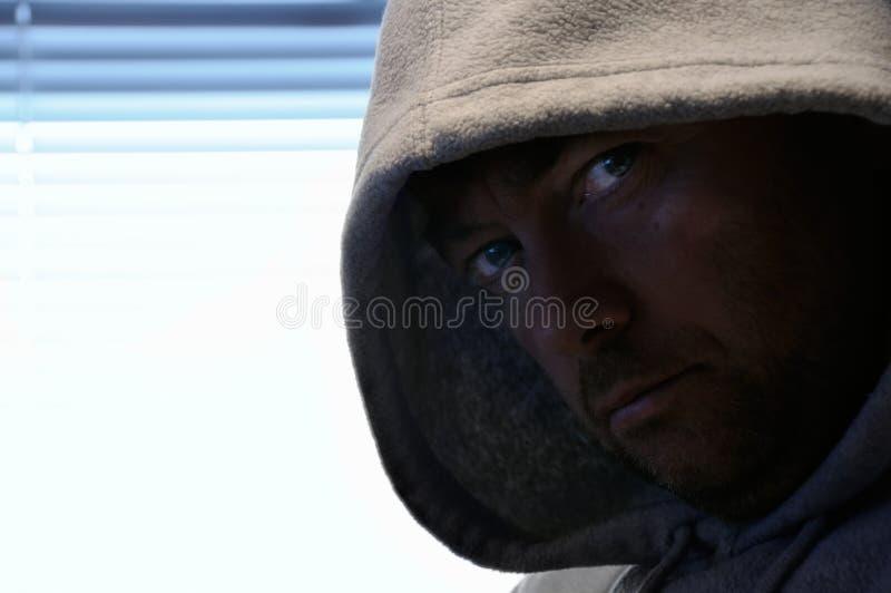 hooded man royaltyfri foto