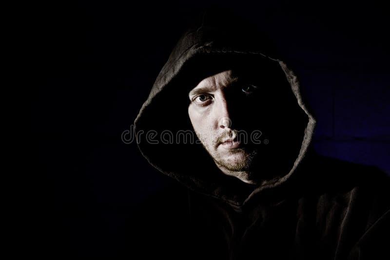 hooded manlig fotografering för bildbyråer