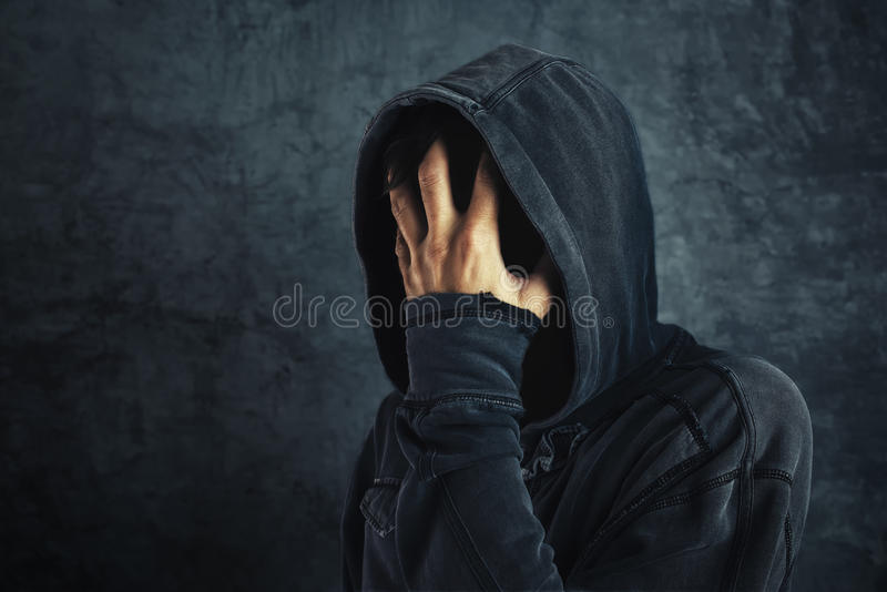 Hooded person fighting addiction crisis. Drug or alcohol addict in abstinence period royalty free stock photos