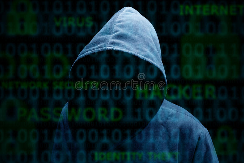 Hooded silhouette of a hacker. Computer hacker silhouette of hooded man with binary data and network security terms