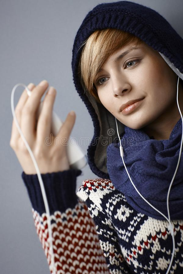 Free Hooded Young Woman Listening Music Stock Photos - 34135263