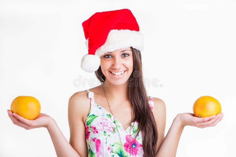 Hoodie na głowie z grapefruits w rękach. obraz royalty free