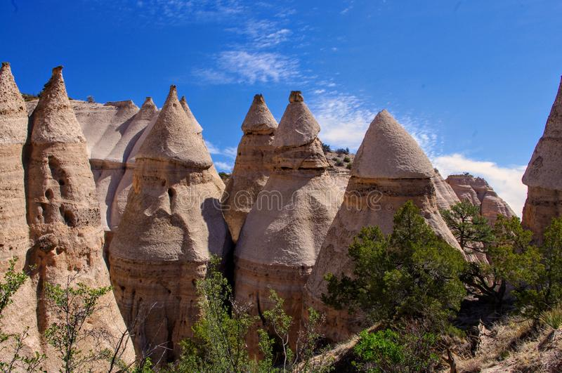 Hoodoo rock formations in Kasha-Katuwe Tent Rocks National Monument, New Mexico. Otherworldly hoodoos and blue skies at Kasha-Katuwe Tent Rocks National Monument royalty free stock photos