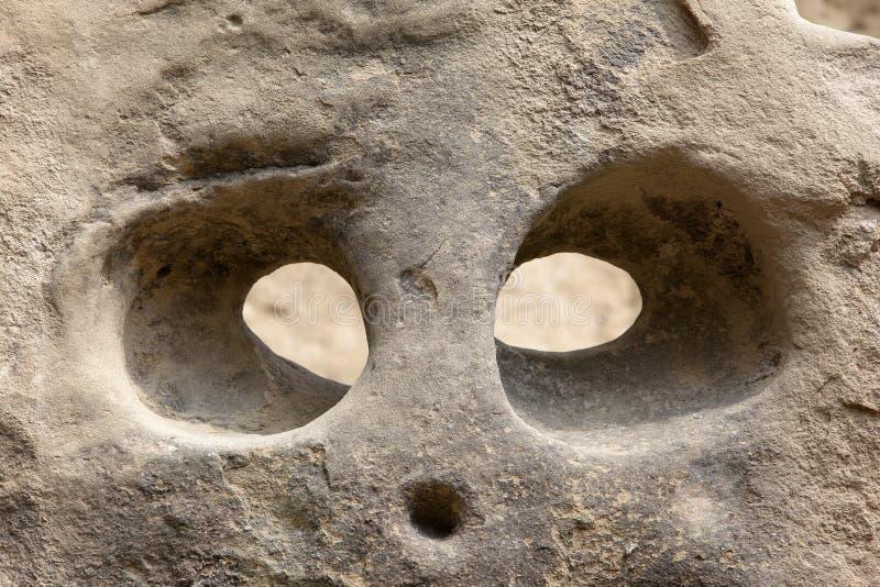 Hoofd dat in rots wordt gesneden stock afbeelding