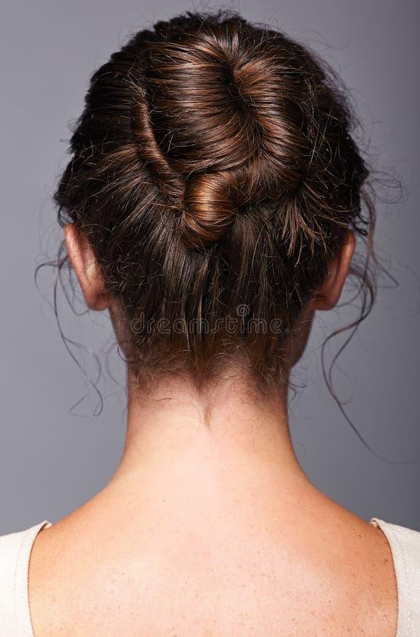Hoofd en schouders van een jonge vrouw van de achterkant Vrouwelijk h royalty-vrije stock foto