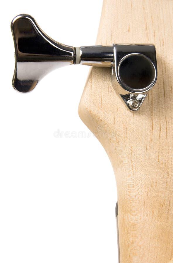 Hoofd het metaalspeld van de basgitaar fingerboard stock foto