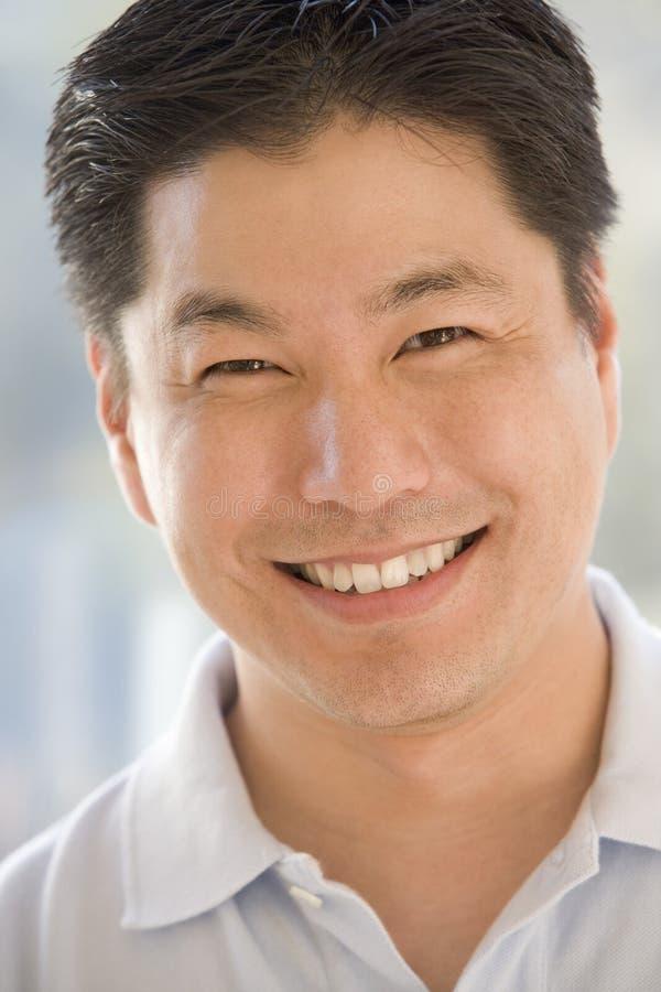 Hoofd schot van mens het glimlachen royalty-vrije stock foto's
