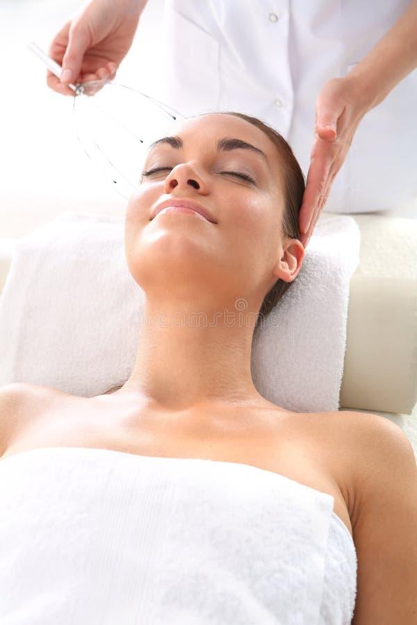Hoofdorgasmator Hoofd massager stock afbeelding