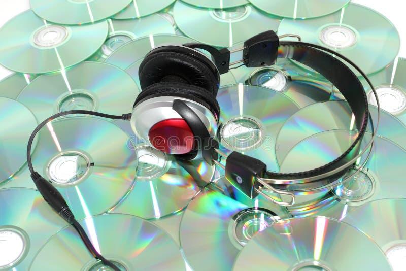 Hoofdtelefoons en CD stock afbeelding