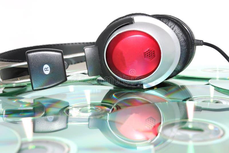 Hoofdtelefoons en CD stock afbeeldingen