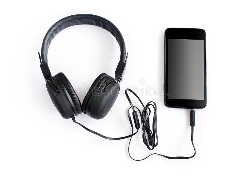 Hoofdtelefoons en smartphone royalty-vrije stock foto