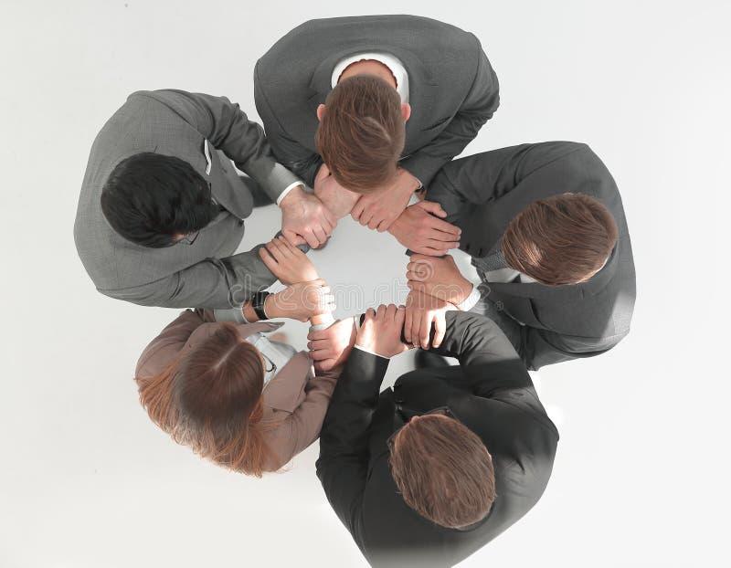 Hoogste mening commercieel team die zich in een cirkel bevinden royalty-vrije stock afbeelding